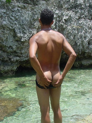 A robust young bronze latino sunbathing among the rocks and wanking that impossibly large dick of his until he cums - Picture 11