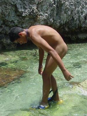 A robust young bronze latino sunbathing among the rocks and wanking that impossibly large dick of his until he cums - XXXonXXX - Pic 12