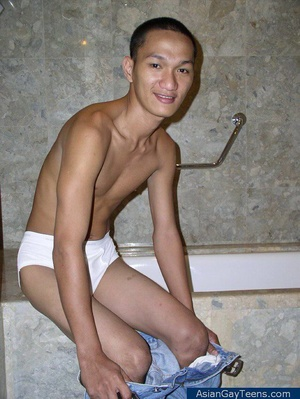 Asian dude gets nude to show off lean slim frame and cock in bathroom - XXXonXXX - Pic 1