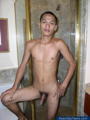 Asian dude gets nude to show off lean slim frame and cock in bathroom - XXXonXXX - Pic 10