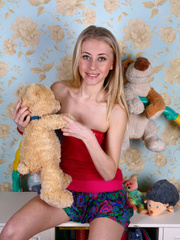 Teen blondie takes off her clothes to pose nude in - XXXonXXX - Pic 1