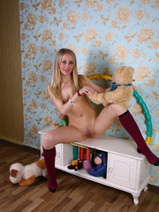 Teen blondie takes off her clothes to pose nude in - XXXonXXX - Pic 20