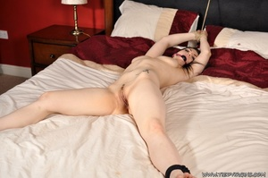 Brunette sub not too happy about being spread eagled on the bed with her sweet tight pussy exposed - XXXonXXX - Pic 1