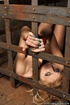 Blonde virgin slut pleads with her eyes as she is gagged, bound, and locked