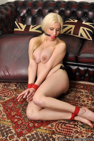 Busty blonde bitch is helpless on the couch with her wrsits and ankles tied together - XXXonXXX - Pic 9