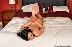 Sexy brunette sub with a pink ball gag teases with her naked body as she struggles from being hogtied on the bed - XXXonXXX - Pic 1