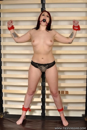 Fiesty red haired virgin struggles against her restrints while being bound spread eagle on a rack - XXXonXXX - Pic 1
