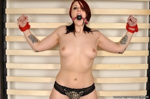 Fiesty red haired virgin struggles against her restrints while being bound spread eagle on a rack - XXXonXXX - Pic 7