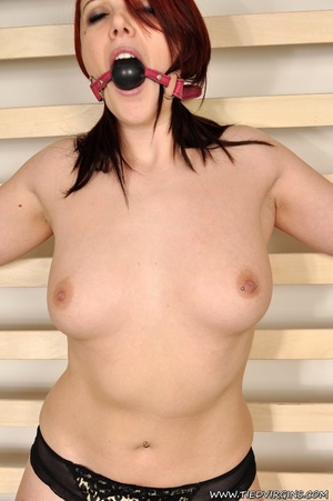 Fiesty red haired virgin struggles against her restrints while being bound spread eagle on a rack - XXXonXXX - Pic 9