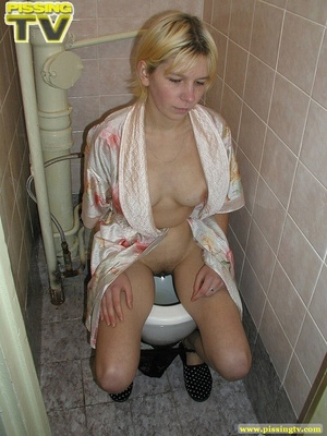 A slutty blonde bitch demonstrates how enjoyable  taking a piss in the toilet can be - XXXonXXX - Pic 13