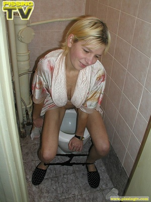 A slutty blonde bitch demonstrates how enjoyable  taking a piss in the toilet can be - XXXonXXX - Pic 15