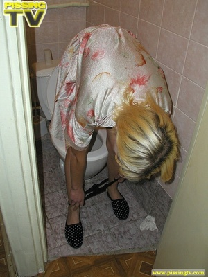 A slutty blonde bitch demonstrates how enjoyable  taking a piss in the toilet can be - XXXonXXX - Pic 17