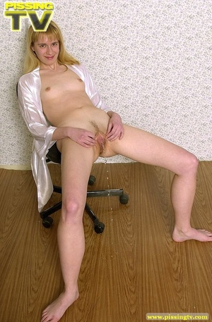 Naked blonde slut sits on a swivel chair while she takes delight in squirting warm golden pee all over the floor and on her feet - XXXonXXX - Pic 9