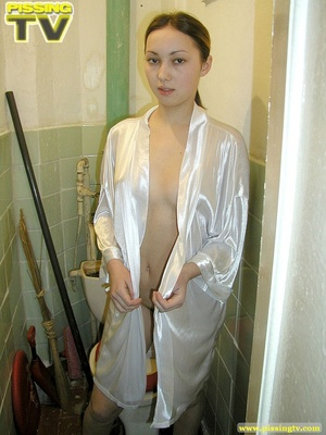 Brunette beauty wearing only a silk robe takes a wonderfully nasty piss inside a very dirty toilet by sitting on the toilet seat - XXXonXXX - Pic 16