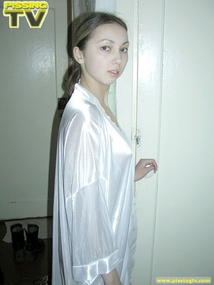 Brunette beauty wearing only a silk robe takes a wonderfully nasty piss inside a very dirty toilet by sitting on the toilet seat - XXXonXXX - Pic 20