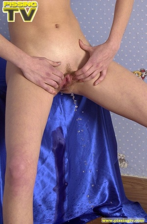 Exquisite blonde beauty enjoys spreading her pussy lips and gushing her warm piss in a blue colored room - XXXonXXX - Pic 18