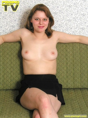Nasty busty brunette beauty lounges on a living room sofa naked then positions herself and releases a golden shower of pee on the floor - XXXonXXX - Pic 3