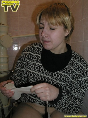 Blonde bitch sits on the toilet and enjoys some moments of wonderful piss coming from her tight sweet cunt - XXXonXXX - Pic 16