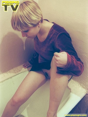 Petite blonde teen went to the bath for a rather exciting pissing opportunity where she released her warm golden pee in the bath - XXXonXXX - Pic 3