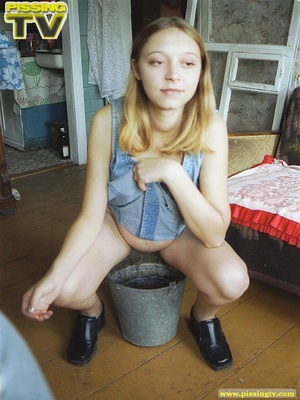 Innocent blonde teen enjoys being able to let loose her steaming golden piss in a bucket where her piss creates so much noise as it splashes - XXXonXXX - Pic 9