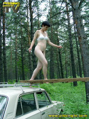 Half naked teen walks on a ladder proped on two - XXXonXXX - Pic 2