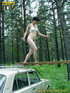 Half naked teen walks on a ladder proped on two…