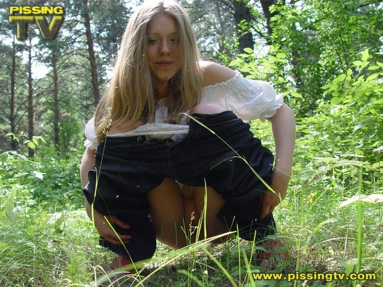 Blonde teen girl pulling down pants
