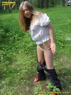 Teen girl pulling down pants consider
