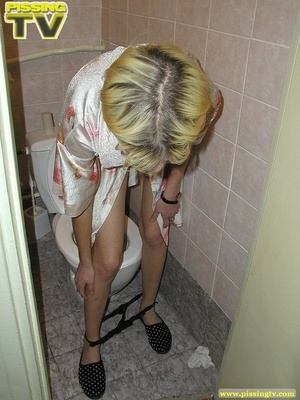 A slutty drunk blonde bitch demonstrates how enjoyable  taking a piss in the toilet can be - XXXonXXX - Pic 17