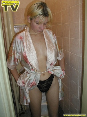 A slutty drunk blonde bitch demonstrates how enjoyable  taking a piss in the toilet can be - XXXonXXX - Pic 19