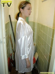 Brunette beauty wearing only a silk robe takes a wonderfully nasty piss inside a very dirty toilet by sitting on the toilet seat