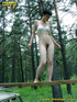 Daring brunette teen balances on a ladder proped…