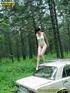 Daring brunette teen balances on a ladder proped…