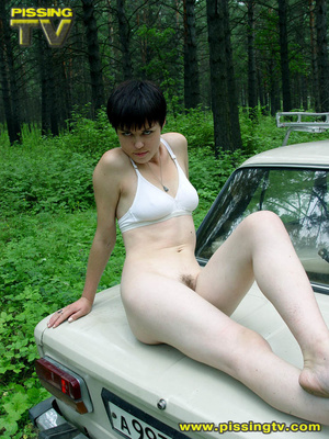 Daring brunette teen balances on a ladder proped on two cars, squats and relieves herself right there with out caring as to who is watching her - XXXonXXX - Pic 20