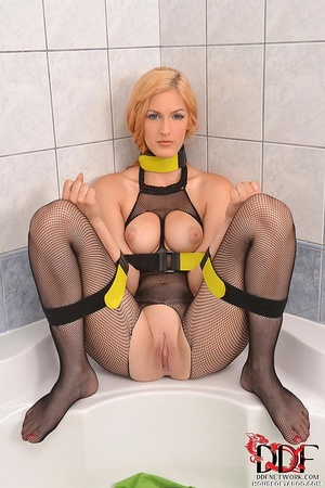 Beautiful blond bitch wearing only fishnet stockings is restrained by her arms bound to her legs could not help but release that warm golden liquid from her sweet pussy into the tub - XXXonXXX - Pic 2