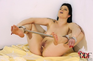 Lovely brunette temptress is restrained in spreader bars on her ankles and wrists lying down on a bed, since she isn't going anywhere she just pissed on bed - XXXonXXX - Pic 5