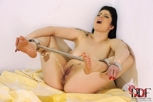 Lovely brunette temptress is restrained in spreader bars on her ankles and wrists lying down on a bed, since she isn't going anywhere she just pissed on bed - XXXonXXX - Pic 7