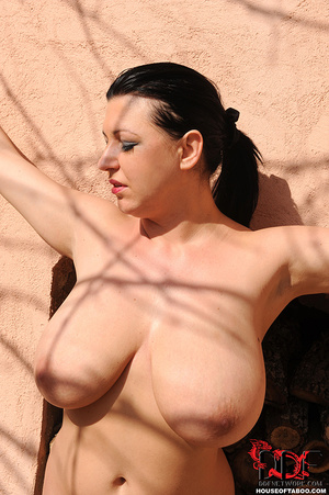 Very busty brunette beauty is tied spread eagled outdoors along the wall of a house and had no qualms about pissing right there - XXXonXXX - Pic 15
