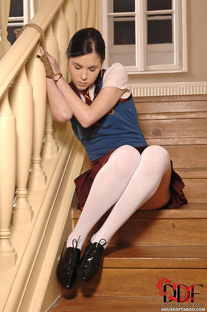 As punishment, a naughty coed slut is tied to the stairs banister but because she felt she had to go she pissed on the stairs - XXXonXXX - Pic 3