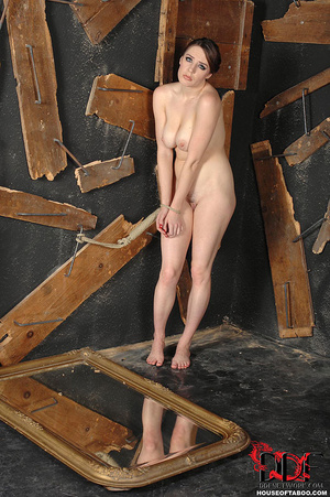 Bound nude brunette can't resist pissing on broken mirror on the floor then she delights in licking her piss off it - XXXonXXX - Pic 2