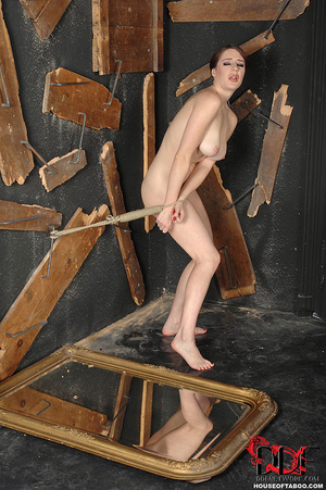 Bound nude brunette can't resist pissing on broken mirror on the floor then she delights in licking her piss off it - XXXonXXX - Pic 5