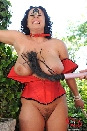 Very busty brunette with nose hooks is tied in the bushes of a garden then is whipped on her breasts by her merciless dom then made to piss - XXXonXXX - Pic 7