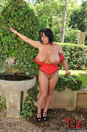 Very busty brunette with nose hooks is tied in the bushes of a garden then is whipped on her breasts by her merciless dom then made to piss - XXXonXXX - Pic 15