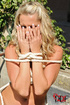 A sexy blonde sub is tied up shibari style in a garden then she just pisses