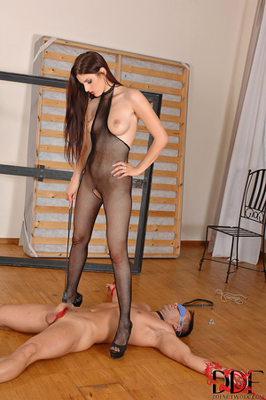 Lusty brunette dom in fishnet body suit squats over and pisses on a nice thick cock tied  with crotch rope - XXXonXXX - Pic 3