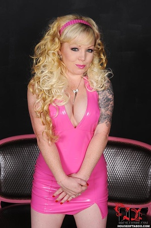 Big boobed slutty blonde in hot pink leather dress with arms chained to body squats with legs wide apart and pissed on the floor - XXXonXXX - Pic 16