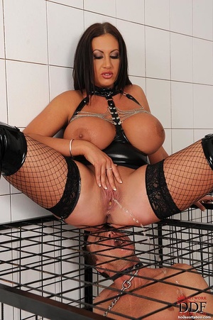 Busty brunette dom cages a naked man sub then she pisses over sub on the cage and the sub licks her piss and butt thru the cage - XXXonXXX - Pic 9