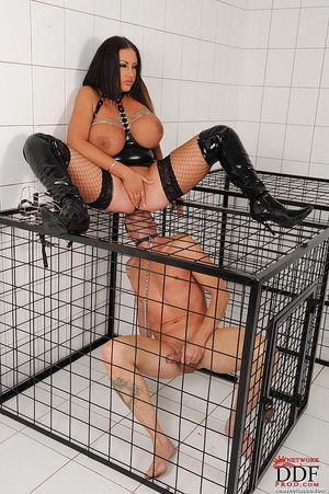 Busty brunette dom cages a naked man sub then she pisses over sub on the cage and the sub licks her piss and butt thru the cage - XXXonXXX - Pic 11