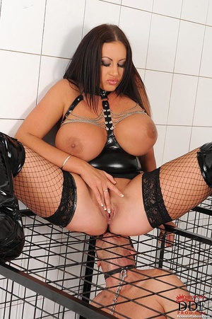 Busty brunette dom cages a naked man sub then she pisses over sub on the cage and the sub licks her piss and butt thru the cage - XXXonXXX - Pic 12