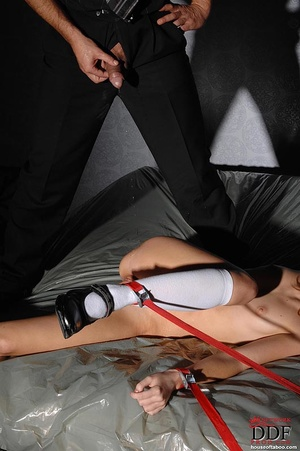 An innocent nude girl except for her shoes and knee high socks is  gagged, tied spread eagle with one leg lifted is pissed on her pussy by male dom then gives a blowjob - XXXonXXX - Pic 7